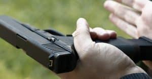 Loading Handgun. Reloading handgun. Man Reloading handgun.