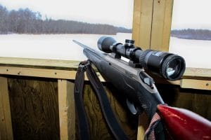 Side View Of A Rifle In A Hunting Blind