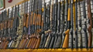 Blurred Photo Of Gun Rifle Display For Sale In Pawn Shop
